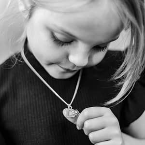 young girl wearing initials necklace childrens jewellery